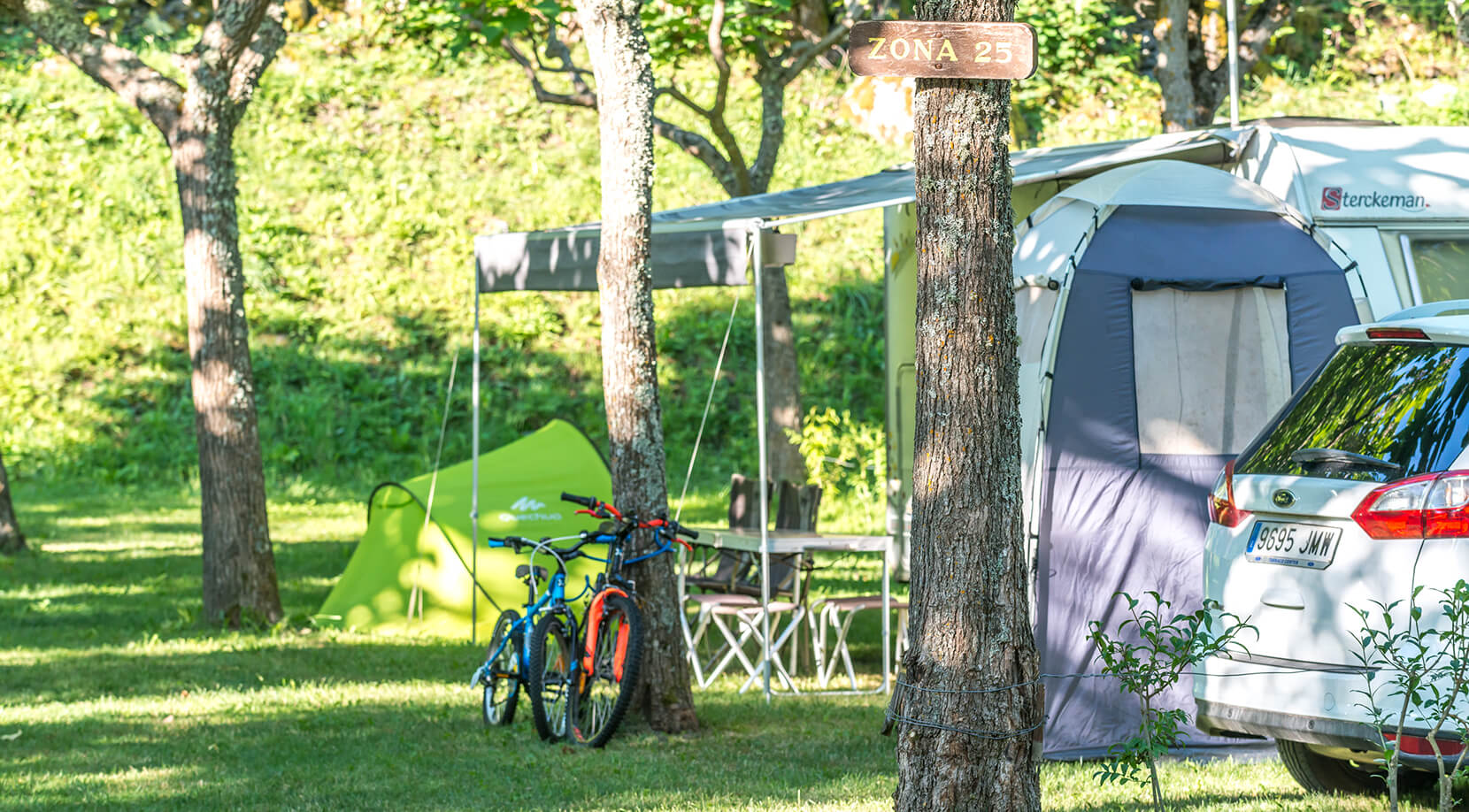 Campsite in a populated area of trees along the Garonne River
